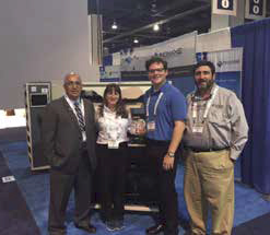 Team Inovaxe with the NPI award-winning InoAuto SMART Mix cart